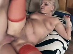Horny blonde granny Ursula wearing stockings is having fun with some guy indoors. She drives him crazy with a great blowjob and then gets her cunt pounded doggy style.
