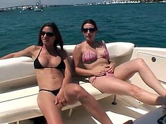 Brunette chicks have a great time together on the boat. After some time they start to lick each others wet pussies.