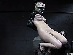 Pretty blonde Lexi Belle allows some guy put her into irons in a basement. The dude torments the girl and then fucks her snatch with a massive dildo.