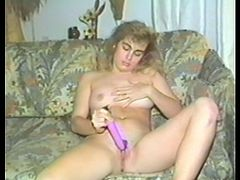 A slutty long-haired vintage blonde is having some good time alone. She strokes her tits and ass ardently and then smashes her snatch with a dildo.