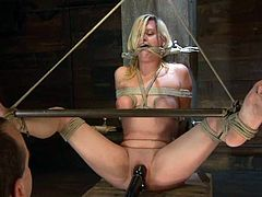 Adorable blonde girl lies on the floor being tied up. Later on she gets her tits tortured and pussy drilled with a fucking machine.
