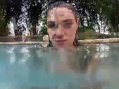 Charley Chase is a kinky underwater Hottie in this amazing free porn video. See her showing her big round tits while taking a dip in the pool for your enjoyment.