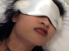 The blind asian babe drilled by a white dick in this free sex tube. She is blindfolded and is pleasured by a various dildos and vibratos. She gets her pussy eaten out and then rides his big cock