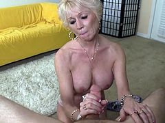 Alluring mature with great boobs strokes this dick in a sexy handjob porn show
