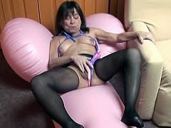 Black haired ugly MILF with disgusting saggy tits exposes her flabby ass wearing crotchless pantyhose. Old whore rubs her shaved cunt in doggy pose.