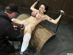 Kinky bitch with twisted boobs gets tied up. Then her master starts to toy her vagina with a vibrator.