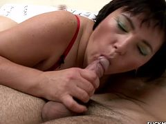 Chubby mature skank Anna wearing red lingerie and stockings rubs her meaty snatch and gets horny. Then she gives a blowjob to some dude and fucks him in cowgirl position.