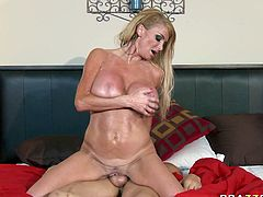 Oiled blonde milf Taylor Wane rides cock face to face and reverse