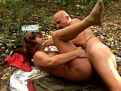 Lustful mom Mandy is playing dirty games with some guy in the forest. They stimulate each other's privates passionately and then fuck in cowgirl and missionary positions on the ground.