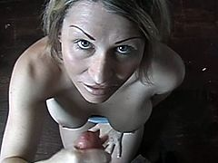 Nasty blonde chick strips and shows her tits to some man. Then she squats in front of him and rubs his weiner till it explodes with jizz.