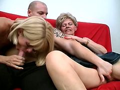 Bald tattooed fucker is on the sofa while two mature sluts suck his stiff prick and prepare it for wild ride in this perfect threesome scene.