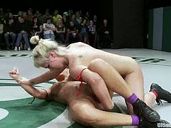 This girls are really hot, so you must see this video. Girls from the winning team use their strap-ons to punish opponents.