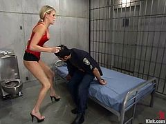 Dominant blonde Audrey Leigh is having fun with Ricosf in a jail. She beats the dude and then drills his tight butt with a big strapon.