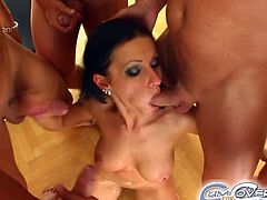 Press play on this hardcore scene and watch this slutty brunette being nailed by various cocks in a hot gangbang.
