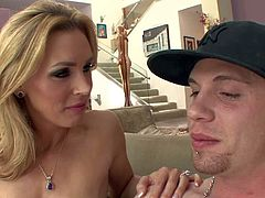 Smoking hot blonde milf Tanya Tate with awesome body and big jaw dropping hooters in tight green dress and high heels seduces John Espizedo and starts playing with his meaty pecker.