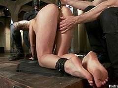 Dahlia Sky to balance on a board while nipple clamps are attached to her tits. Her sex master Owen whips her young cunt. She has to bend over so he can stick a metal dildo in her butthole. She sucks cock while her ass is rammed.