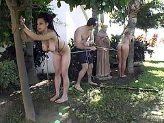 Jenni Lee and Mallory Knots are having fun with some guys in the garden. They get bound and beaten and then endure pain and humiliation.