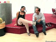 Dress in a body hugging latex and stocking, busty brunette Christina Jolie looks fucking hot in eye glass. Down on her knees as she gives head to her man then ride his hard tool that goes hard in her mound.