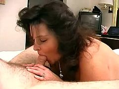 Chubby brunette mom Raven strips and demonstrates her body to some guy. Then she sucks and rubs the nerd's prick and they have sex in missionary position.