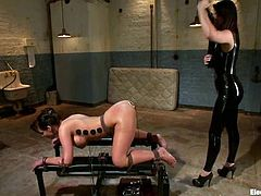 Phoenix stands on all fours and gets her ass fingered. Then she also gets wired and toyed rough with electro dildo by Bobbi Starr.