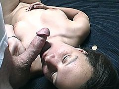 Kinky brunette girl strips the clothes off and lies down on the bed. Then the guy comes up to her and she gives him a blowjob. After that she also gets her face cum covered.