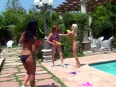 Gianna Lynn, Victoria and Alexandra take sunbathes and have a lot of fun in a backyard. Then these hotties go inside and toy each others wet pussies with big dildos.
