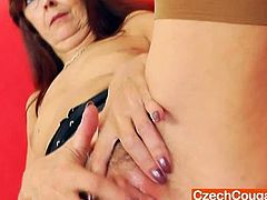 Lada gapes her unshaved fuck hole in juicy panty-hose and heels.Watch how she sits back on the couch while spreading her legs and toying her hairy cunt deep with big dildo.