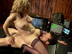 Nasty blonde mistress ties the guy up and fixes clothespins to his body. Later on she toys his ass with a strap-on and sits on his face.