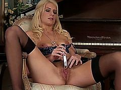 Leggy blonde cougar in training spreads her stocking clad legs to massage her furry pussy and swollen clit to climax with her favorite vibe