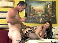 Wicked brunette MILF with really hairy pierced pussy takes a long ride on that fat cock in reverse cowgirl pose and later gets her bearded clam fucked doggystyle.