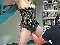 Extreme amateur slut is tied in bondage at the video store and fist fucked in her cavernous cunt