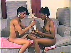 This is a retro porn video and these two stunning ebony chicks are gonna share that huge dildo! Their lesbian passion is so seductive.