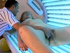 Lewd blonde mom Jamie is playing dirty games with some dude in a solarium. She lets the man rub her hairy pussy and then they have sex in missionary position on the floor.