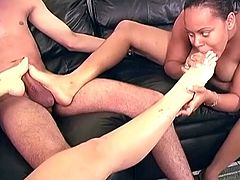 Chubby ebony and slim White chicks lick each others feet. Then they suck a dick and give a footjob at the same time.