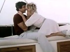 Sassy blonde is kissing and blowing cock on a yacht