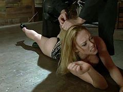 Superb blonde girl with juicy tits gets undressed and tied up. Later on she gets her tits tortured with claws and clothespins. Then she also gets her shaved pussy fingered.