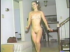Amateur girl lies on a sofa and masturbates in retro video. Then she also takes a shower and shows her pussy in close-up scenes. After that she gets toyed by her girlfriend.