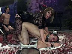 Unmerciful mistress tortures her sex slaves with clothespins. Then she drills their asses with a strap-on and rides dicks.