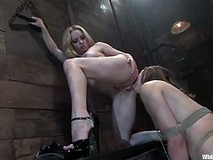 Busty blonde mistress Aiden Starr is getting naughty with Savannah West in a basement. Aiden binds Savannah and drills her pussy with a strapon before showing her nice fisting skills.