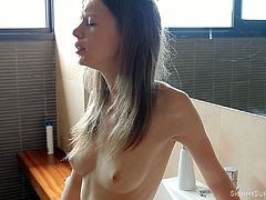 When Gloria wakes up she goes into the bathroom to brush her teeth, but she is so horny she ends up rubbing her clit and cumming.