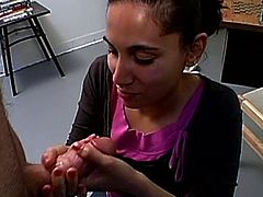 A kinky Indian bitch and some dude are having fun in an office. She slut kneels in front of the stud and begins to lick and rub his wang passionately.