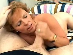 Get wild watching this short haired mature lady with natural knockers, while she uses her mouth to give pure pleasure to this fellow.