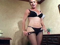 Watch this horny short haired blonde milf getting her lusty cunt fucked by a young stud.She sucks his big hard young cock and let him bang her tight cunt as hard as he can.