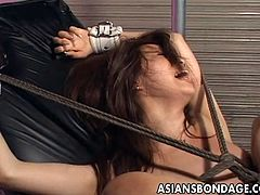 This Asian bitch is ties up really good with rope. A guy is torturing her pussy with fucking machines. He keeps changing them and increasing the intensity too.