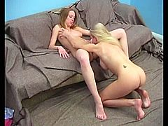 Two skinny fair-haired girls are having fun indoors. They strip and demonstrate their fake tits to each other and then show their nice pussy-licking skills.