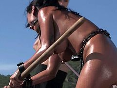 It's an outdoors bondage session where the girl is forced to dig the ground, get totally buried bar her head, then toyed and nipple tortured. All in one.