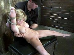 Curvaceous blonde girl get her boobs massaged by a master. Later on she gets hog tied and suspended.