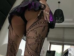 Her fishnet stockings and bodysuit leave very little to the imagination as she sheds her panties and spreads her pussy wide open.