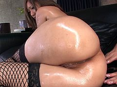 Naughty brunette porn actress named Aika is wearing fishnet stockings. She gets oiled up in oil. Horny dude pleases her coochie with small but powerful sex toy.