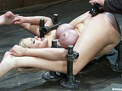 Big-breasted blonde Katie Kox lets some guy put her into fetters in a basement. The man pleases Katie with fingering and makes her cum a few times.